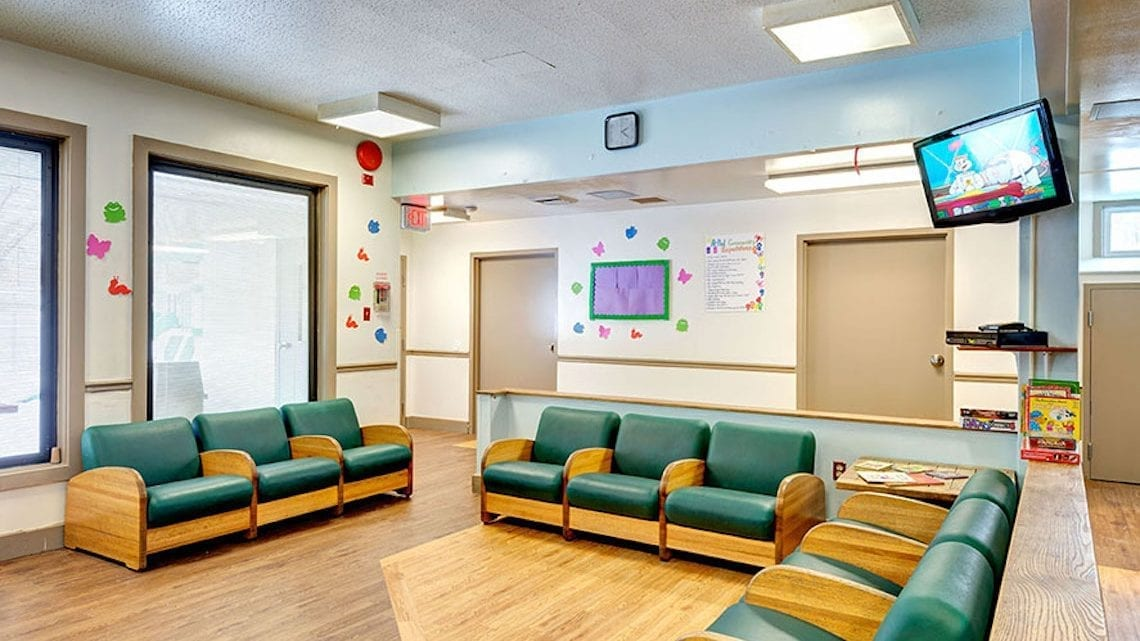 Waiting Lobby with Green Couches and Television | FairmountBHS.com