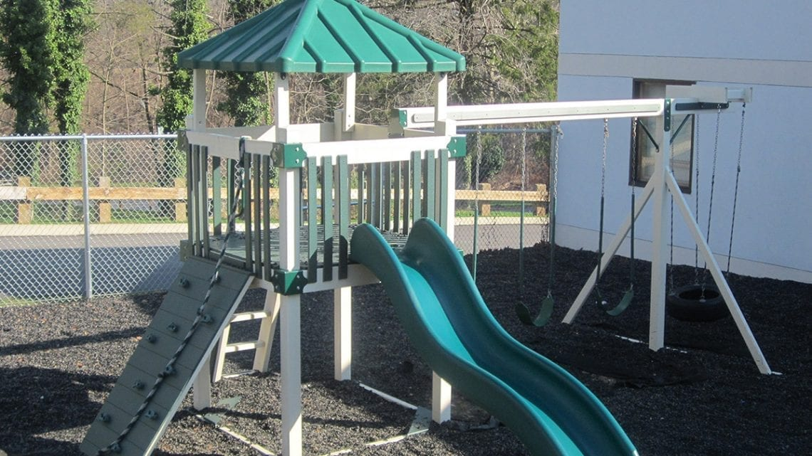 Green and Tan Playground with Swings and Slide | FairmountBHS.com